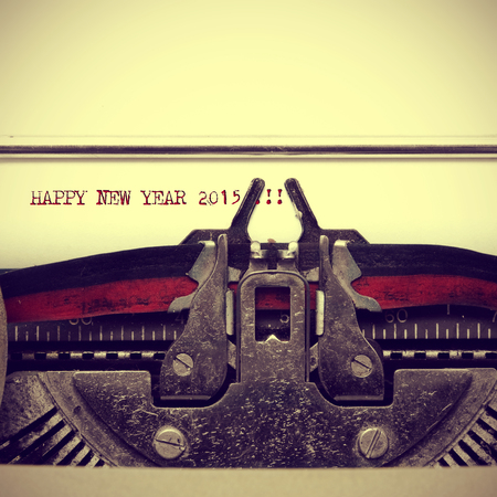 fifteen year old: happy new year 2015 written with an old typewriter, with a retro effect