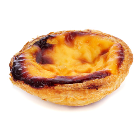 a pastel de nata, typical Portuguese egg tart pastry, on a white background photo