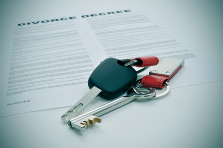 equitable: a divorce decree document and the keys of a car and a house