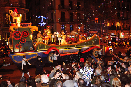 Barcelona, Spain - January 5, 2015: The Cavalcade of Magi in Barcelona, Spain. The Magi and their servants parade in floats by the main streets of the city Editorial