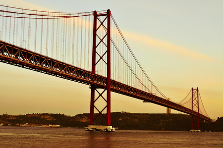 rei: view of the 25 de Abril Bridge and the Cristo Rei in Lisbon, Portugal, with a filter effect Stock Photo