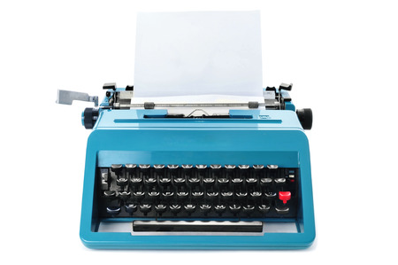 typewriter: a retro blue typewriter with a blank paper on a white background Stock Photo