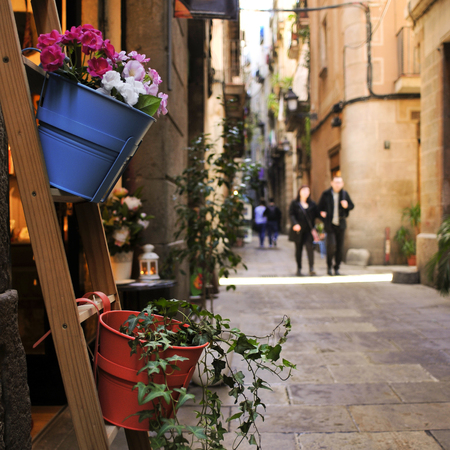 catalonia: view of a narrow street with a village atmosphere in Born district in Barcelona, Spain
