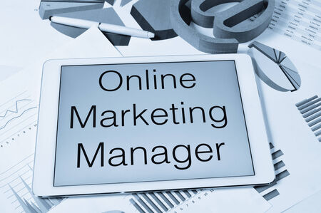 the text online marketing manager in the screen of a tablet