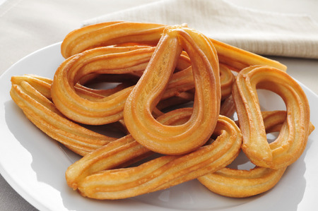 closeup of a plate with some churros typical of Spain 免版税图像