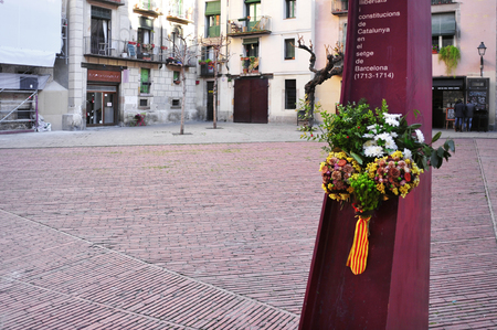 siege: Barcelona, Spain - January 10, 2015: El Fossar de les Moreres in Barcelona, Spain. It is a memorial plaza with an eternal flame in memory to the fallen Catalans in the Siege of Barcelona