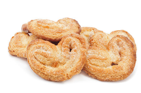 eating pastry: some palmeras, spanish palmier pastries, on a white background Stock Photo