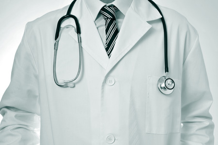 preventive: closeup of a doctor wearing a white coat and with a stethoscope Stock Photo