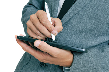 stylus pen: closeup of a businessman using a stylus pen in his tablet