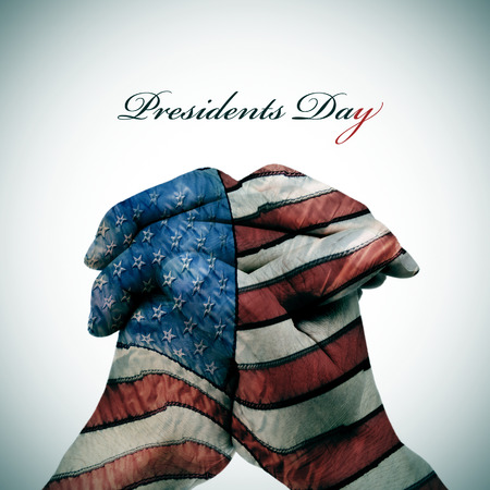 president's day: the text Presidents Day and man clasped hands patterned with the flag of the United States Stock Photo