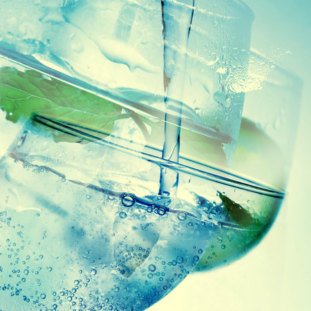 gin: a double exposure of some pictures of mixed drinks in balloon glasses