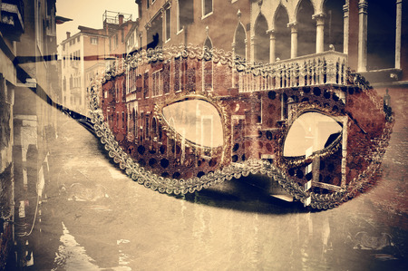 multiple exposure: a double exposure of a carnival mask and a canal in Venice, Italy