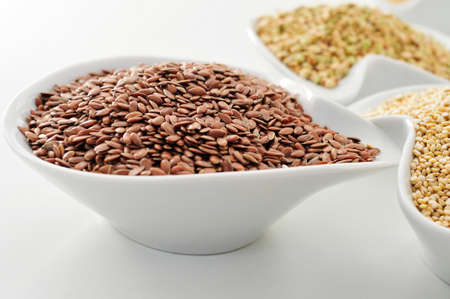 linum usitatissimum: closeup of a bowl with brown flax seeds