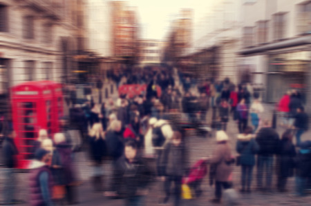 a defocused blur background of people walking in a street in London, United Kingdom photo