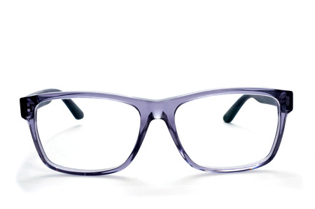 long sightedness: closeup of a pair plastic rimmed eyeglasses on a white background