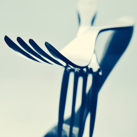 homemaking: closeup of some forks on a reflecting surface, with a filter effect Stock Photo