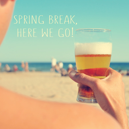 we the people: the text spring break, here we go written on a blurred image of a young man having a beer on the beach