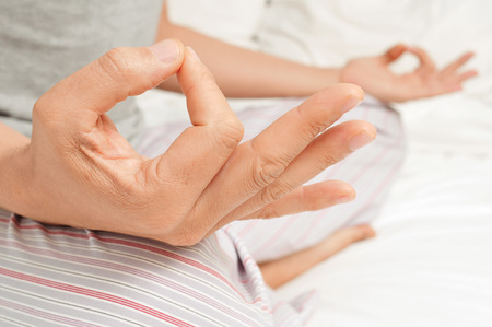 yogi aura: young man meditating with his hands in gyan mudra