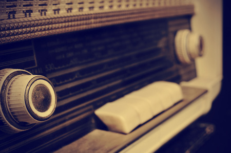 close up of an antique radio receptor, in sepia toning
