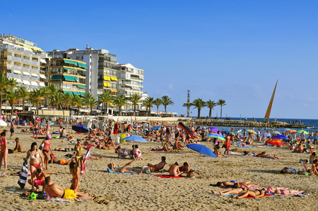 vacationers: Salou, Spain - August 24, 2014: Vacationers in Llevant Beach in Salou, Spain. Salou is a major destination for sun and beach for European tourism with more than 50,000 accommodations