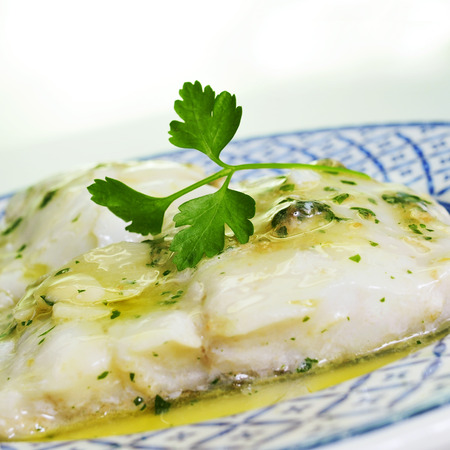 codfish: a plate with bacalao al pil-pil, a typical spanish recipe of codfish with garlic and parsley