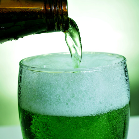 saint patrick's: closeup of a glass with dyed green beer