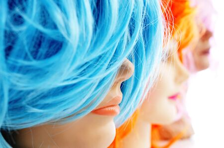 hairdress: closeup of some wigs of different colors on mannequin heads Stock Photo