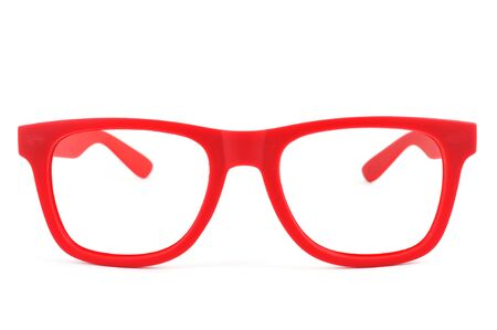 shortsightedness: a pair of red plastic-rimmed eyeglasses on a white background