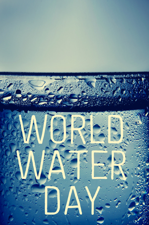 thirstiness: the text world water day written on a glass of cold water