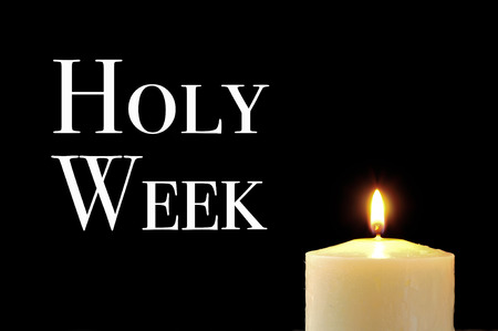 holy week: a lit candle and the text holy week written in white on a black background
