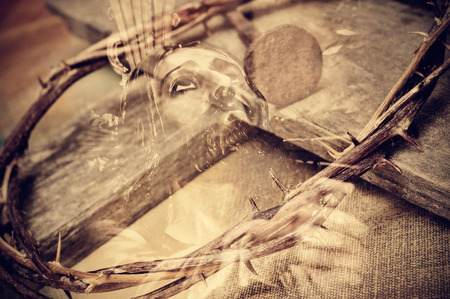 a double exposure of the Jesus Christ carrying the Holy Cross and the Crown of Thorns and one of the Nails of the Cross Stock Photo