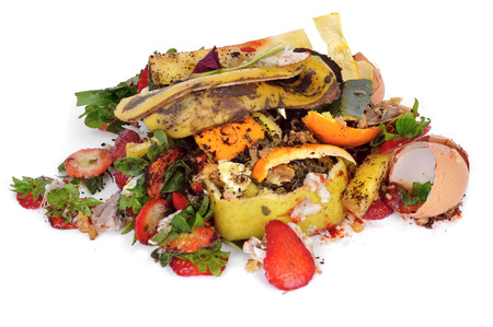 a pile of food waste, such as eggshells and fruit and vegetable peels, on a white background
