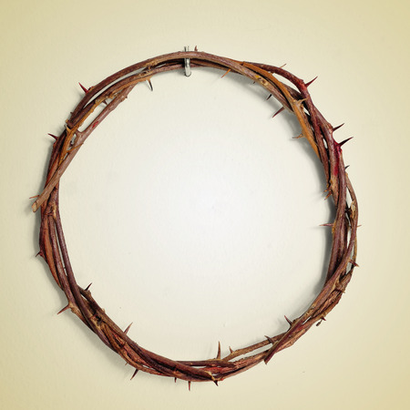 depiction: a depiction of the Crown of Thorns of Jesus Christ hanging from a nail on a wall, with a retro effect Stock Photo