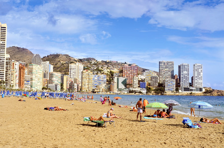 vacationers: Benidorm, Spain - September 22, 2014: Vacationers in Levante Beach in Benidorm, Spain. Also known Beniyork because of the skyscrapers is a major beach destination for European tourism