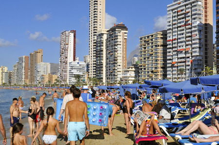 vacationers: Benidorm, Spain - September 23, 2014: Vacationers in Levante Beach in Benidorm, Spain. Also known Beniyork because of the skyscrapers is a major beach destination for European tourism