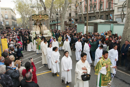 procession: Barcelona, Spain - April 3, 2015: The float with the image of the Macarena Virgin during the Good Friday Procession in Barcelona, Spain. This procession passes through the popular Rambla
