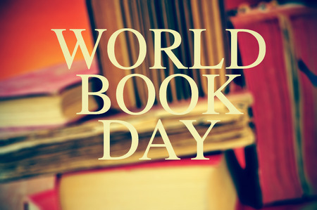 publishers: the text world book day with a pile of blurred old books in the background