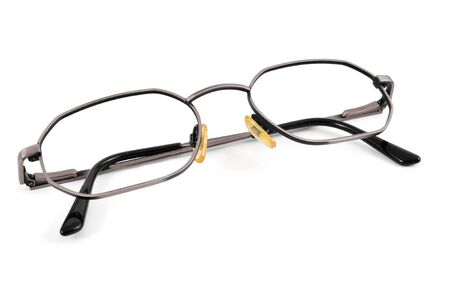 shortsightedness: closeup of a pair of metal-rimmed eyeglasses on a white background Stock Photo