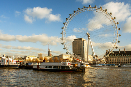 millennium wheel: London, United Kingdom - January 19, 2015: The River Thames and the London Eye in London, United Kingdom. It is the tallest Ferris wheel in Europe with 135 meters high Editorial
