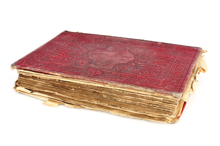wornout: a worn-out old book with a red cover on a white background