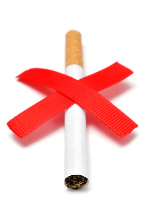 a cigarette and two crossed red slashes, depicting the concept of no smoking, on a white background photo