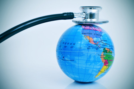check up: an stethoscope on a terrestrial globe depicting the concept of check up the health of the planet earth Stock Photo