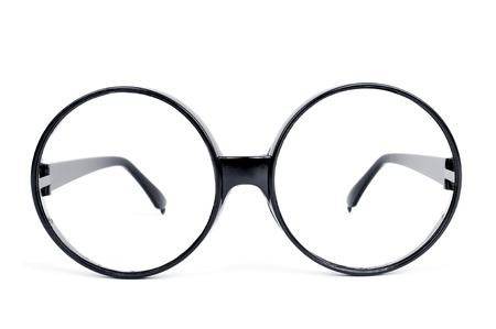 shortsightedness: closeup of a pair of round-lens eyeglasses on a white background