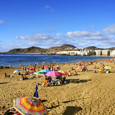 las palmas: Las Palmas, Spain - October 13, 2013: Bathers in Las Canteras Beach in Las Palmas de Gran Canaria, Spain. Due to the tropical weather, the locals can go to the beach almost all year