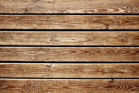 slats: closeup of a surface built of parallel rustic wood slats, to use as a background