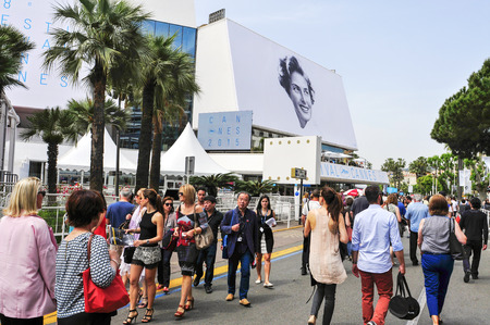 Cannes France May 14 2015: People around the Palais des Festivals in the Promenade de la Croisette during the 68 edition of the Cannes Film Festival in Cannes France