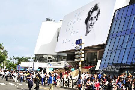 festivals: Cannes France  May 14 2015: People around the Palais des Festivals in the Promenade de la Croisette during the 68 edition of the Cannes Film Festival in Cannes France