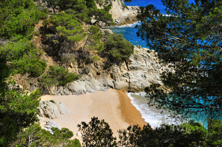 nudism: a view of the Cala den Carles beach in Tossa de Mar, Costa Brava, Catalonia, Spain Stock Photo