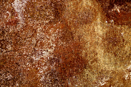 limescale: closeup of a yellow and brown rusty surface