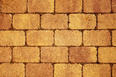 stonemasonry: closeup of a orange stone wall or stone pavement background